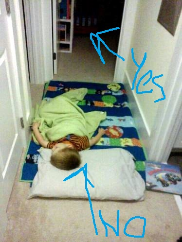 Graham sleeping in the hallway